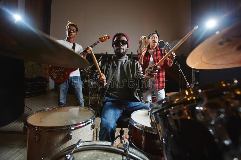 Musical band. Popular music band performing songs and playing musical instruments stock image