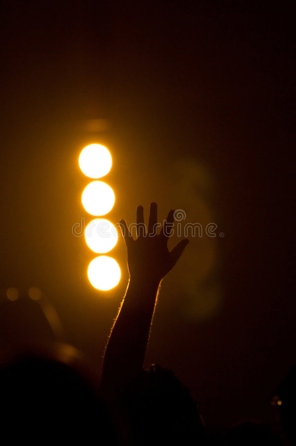 Musical Concert - Christian - with uplifted hands worshipping royalty free stock photography