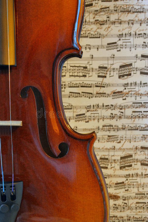 Musical Curves. The graceful curves of a violin against a musical background