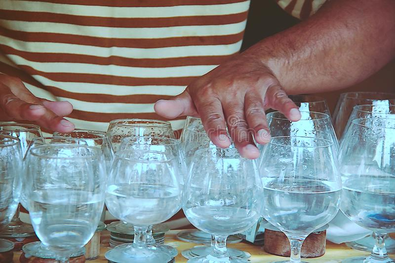 Musical glass or glass harp performance. Musical glasses or glass harp performance.Playing Wine Glass Music stock image