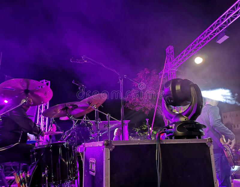 Musical group performance at night. Violet stock photo