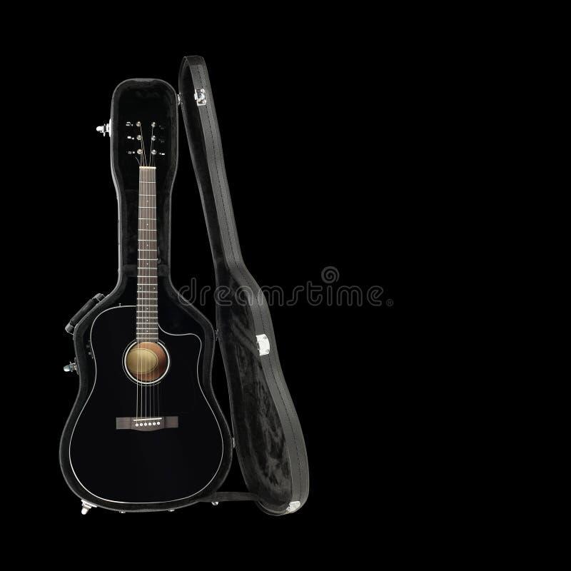 Musical instrument - Acoustic guitar hard case isolated black ba. Musical instrument - Acoustic guitar hard case isolated on a black background stock images