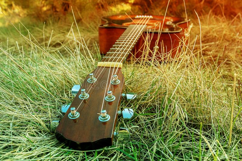 Musical instrument detail. Guitar in the grass royalty free stock photos