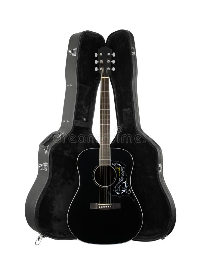 Musical instrument - Front view black folk acoustic guitar in ha. Musical instrument - Front view black folk acoustic country flower bird pickguard guitar in stock photo