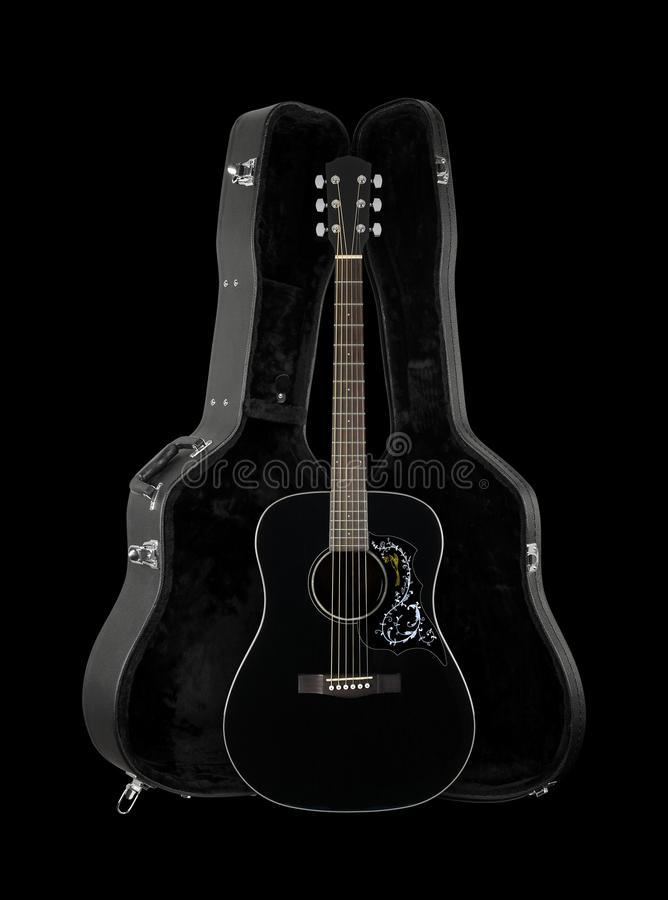 Musical instrument - Front view black folk acoustic western guitar in hard case isolated. Musical instrument - Front view black folk acoustic country flower bird royalty free stock images