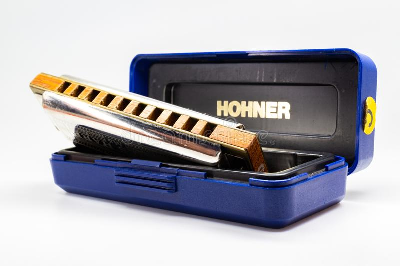 Musical instrument - blues harp in box royalty free stock photo