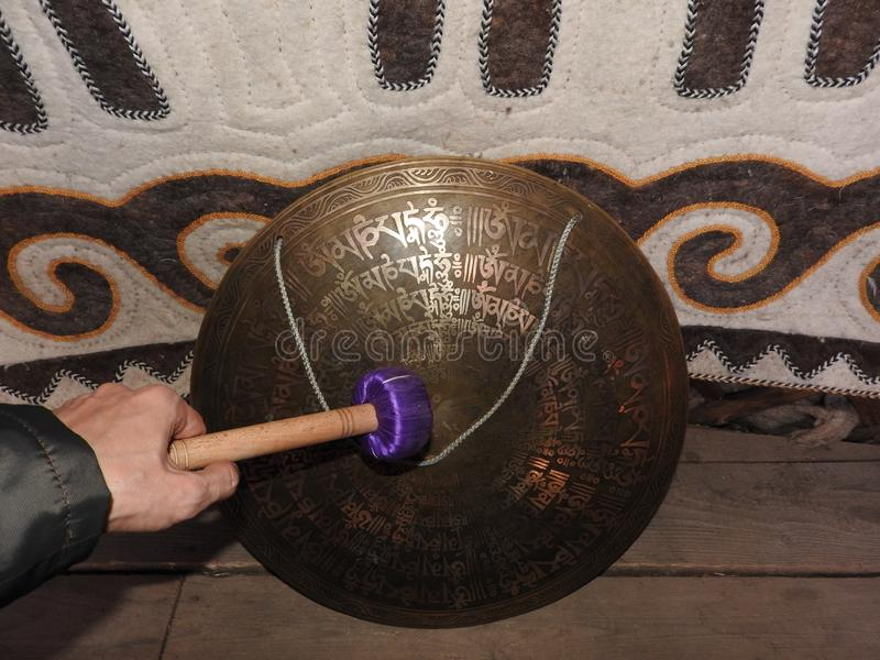 A musical instrument for playing religious music in shamanistic or Buddhist temples. Gong for music performance.  stock photo