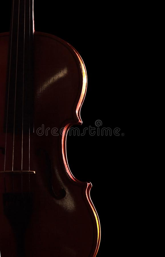 Musical instrument - violin isolated on black stock photos