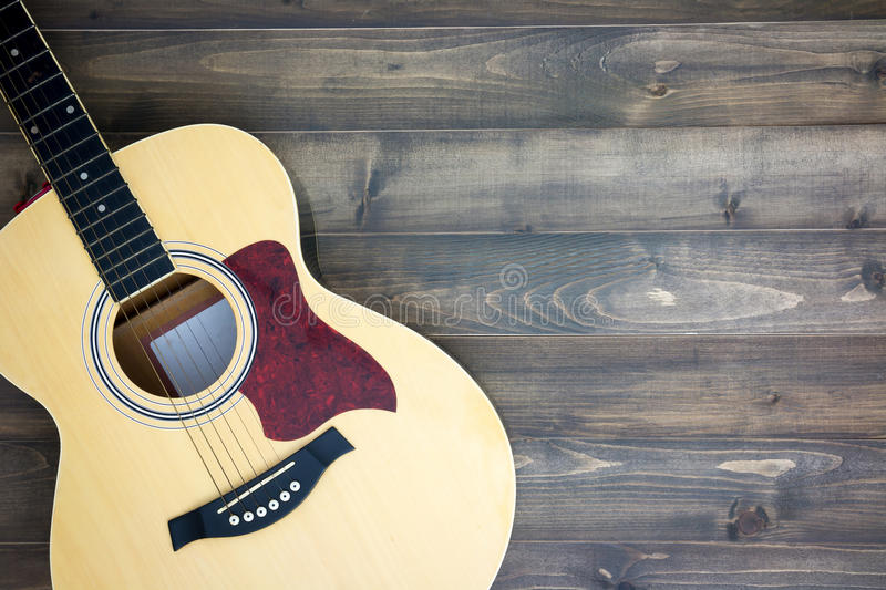 Musical instruments guitar. On old wooden background with copy space. Vintage effect stock photo
