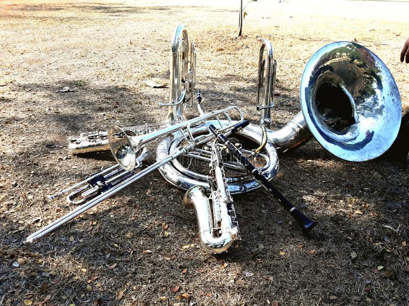 Musical instruments, marching band, put on the ground, Suza Phone, trumpet, clarinet, saxophone. Musical instruments, marching band, put on the ground, Suza stock images