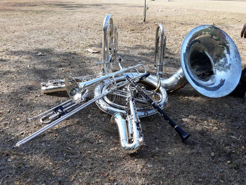 Musical instruments, marching band, put on the ground, Suza Phone, trumpet, clarinet, saxophone.  stock photos