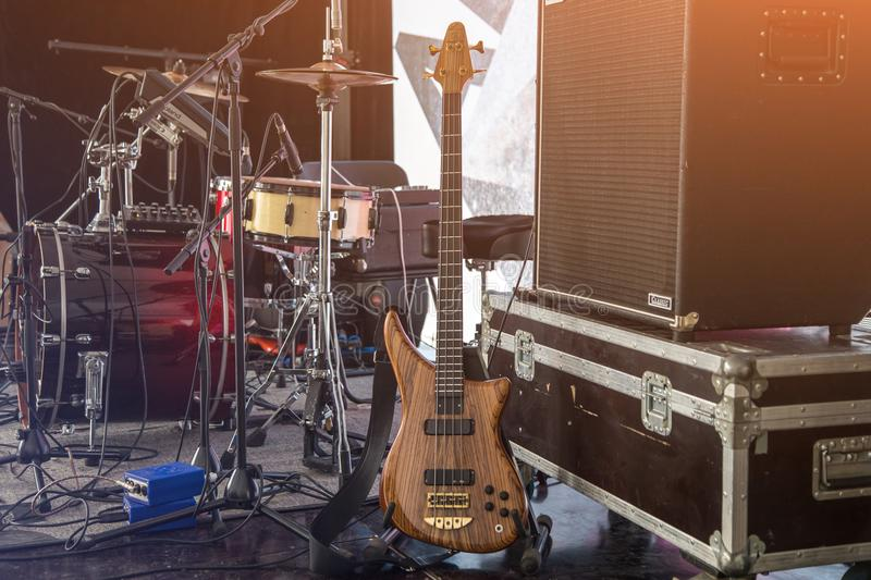 Musical instruments on scene. Musical instruments, bass guitar and drums on scene before the concert. Rock band stock images