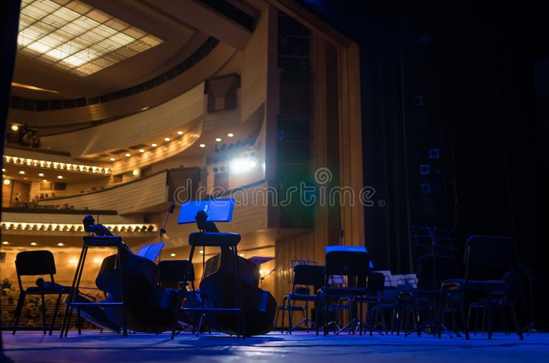 Musical instruments on the stage. Musical instruments in blue light, on stage before performance. A look from behind the scenes royalty free stock photos