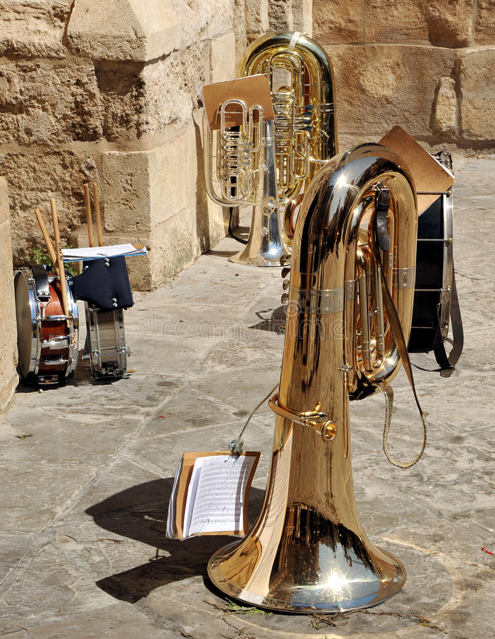 Musical instruments on the street, Seville, Spain. Musical instruments belonging to a brass band during a break royalty free stock photography