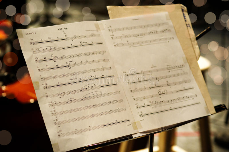 Musical score. Open pages of old yellowing musical score of manuscript royalty free stock images