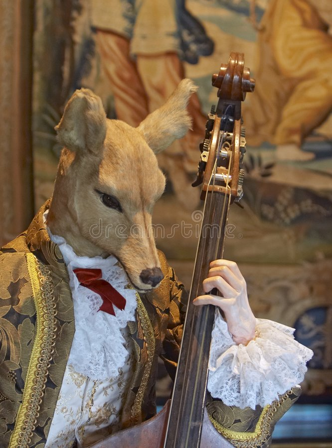 Musician. Stuffed musician, the historic interior royalty free stock images