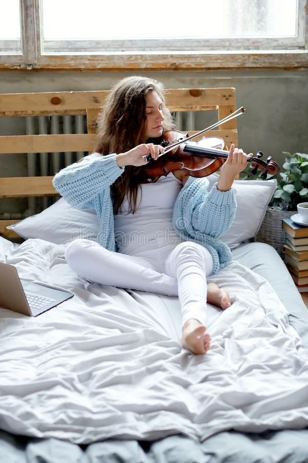 Musician in bed stock photos