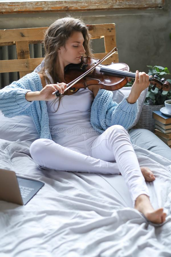 Musician in bed stock images