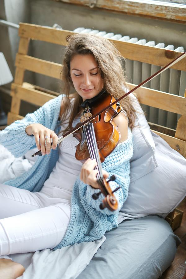 Musician in bed stock image