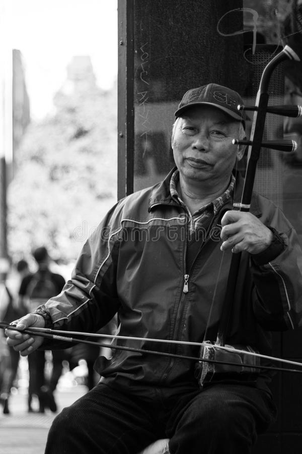 A Musician in Chinatown royalty free stock image