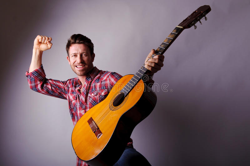 Download Musician With Classic Guitar Stock Image - Image: 25450455