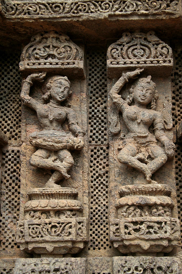 The Musician and The Dancer. Exquisitely carved wall panel depicting a lady musician and a dancer at Sun Temple, Konark, Orissa, India, Asia royalty free stock photos
