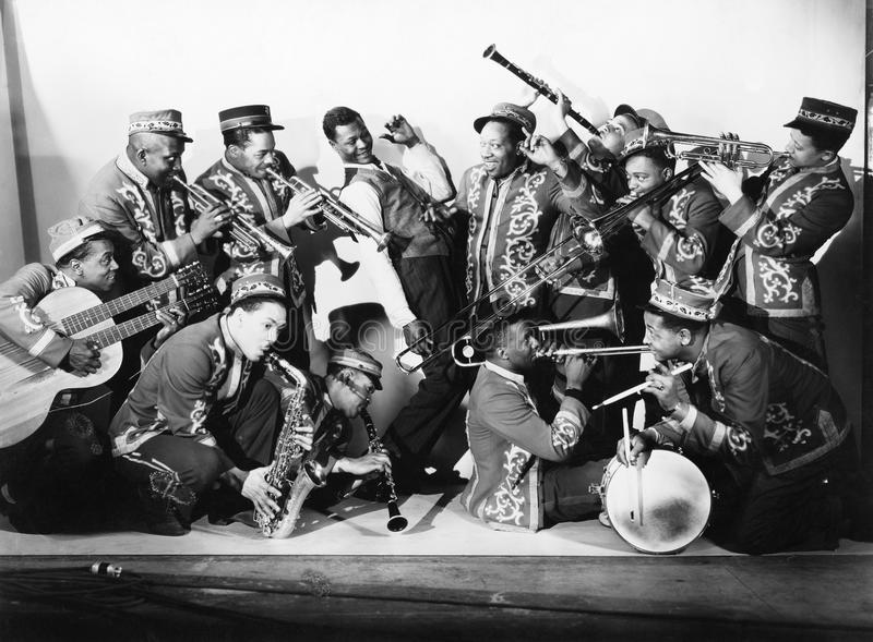 Musician group playing their instruments. (All persons depicted are no longer living and no estate exists. Supplier grants that there will be no model release stock photo