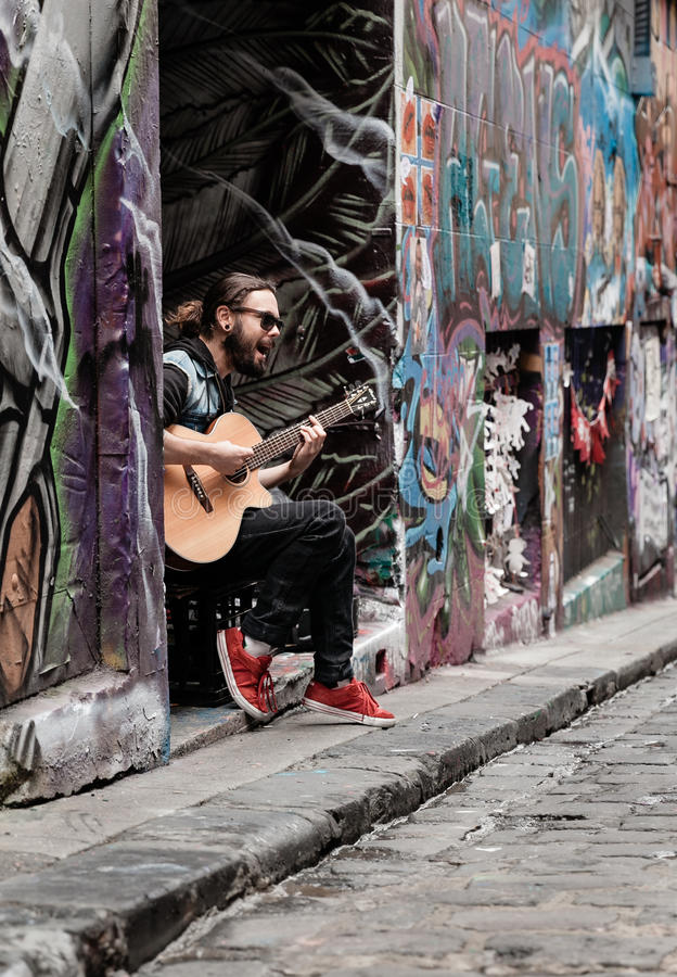 The musician. A guitar player jamming in Hosier Lane Melbourne Australia royalty free stock photo