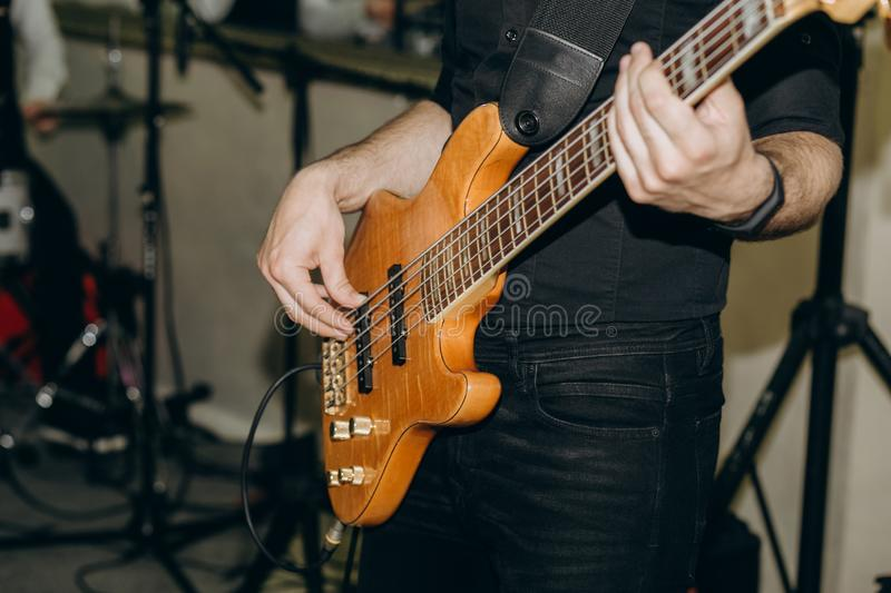 Musician guitar rehearsing tune onstage tunes strings. Musician with guitar rehearsing a tune onstage tunes strings stock photography