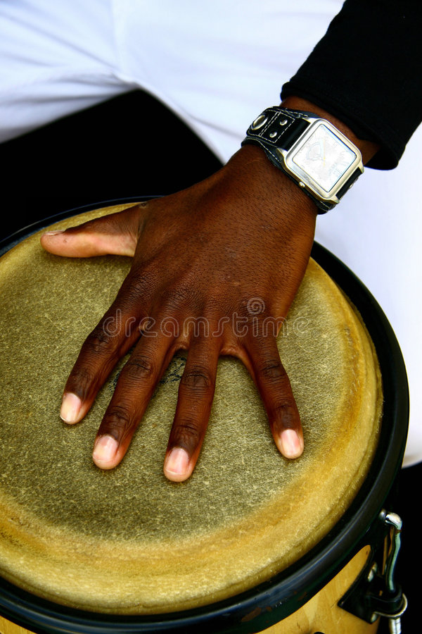 Musician hand. Musician playing drum with watch stock images
