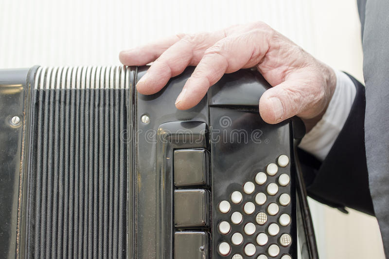 Musician Hand On Harmonica stock image