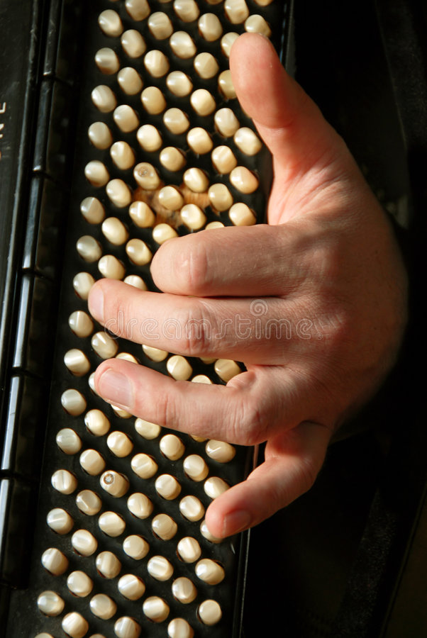 Musician hand playing accordion stock photography