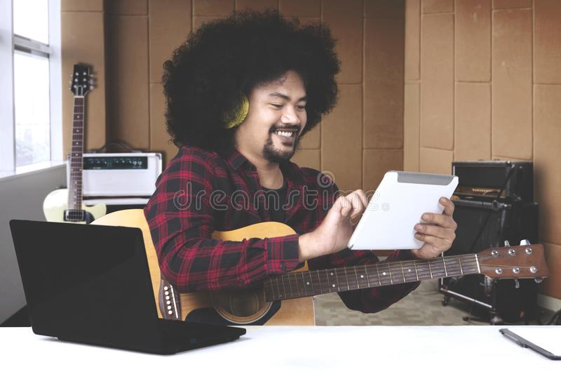 Musician with headset and digital tablet in recording studio stock photos