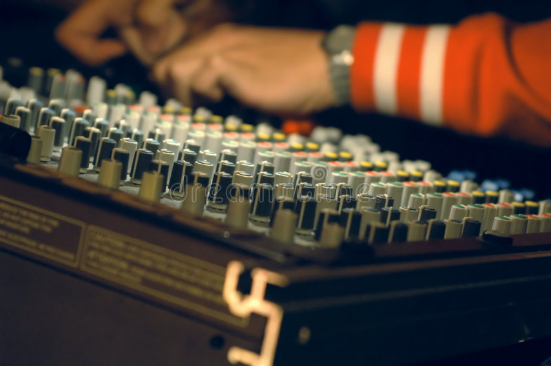 Musician mixing on audio board stock photos
