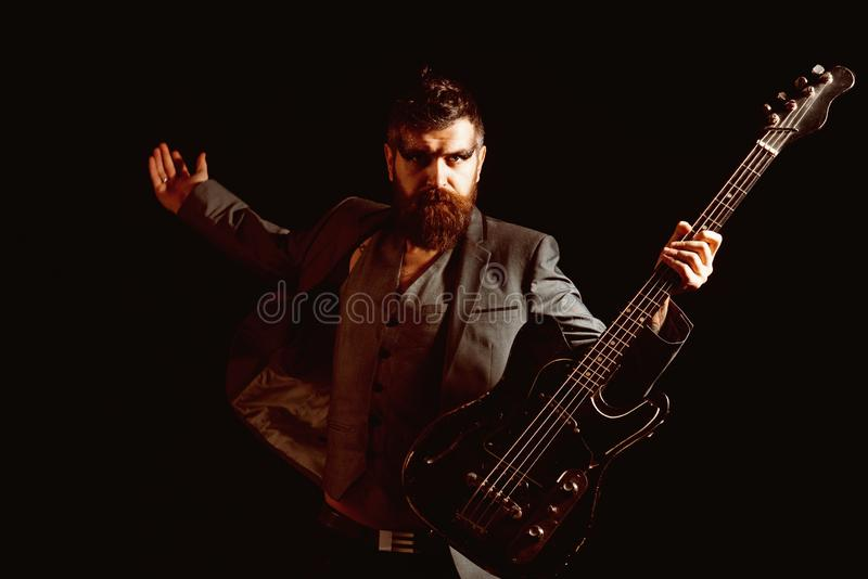 Musician or music player. Bearded musician play guitar. Musician with electric guitar. Rock musician with string royalty free stock photo