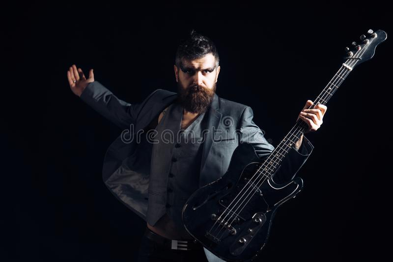 Musician or music player. Bearded musician play guitar. Musician with electric guitar. Rock musician with string stock images
