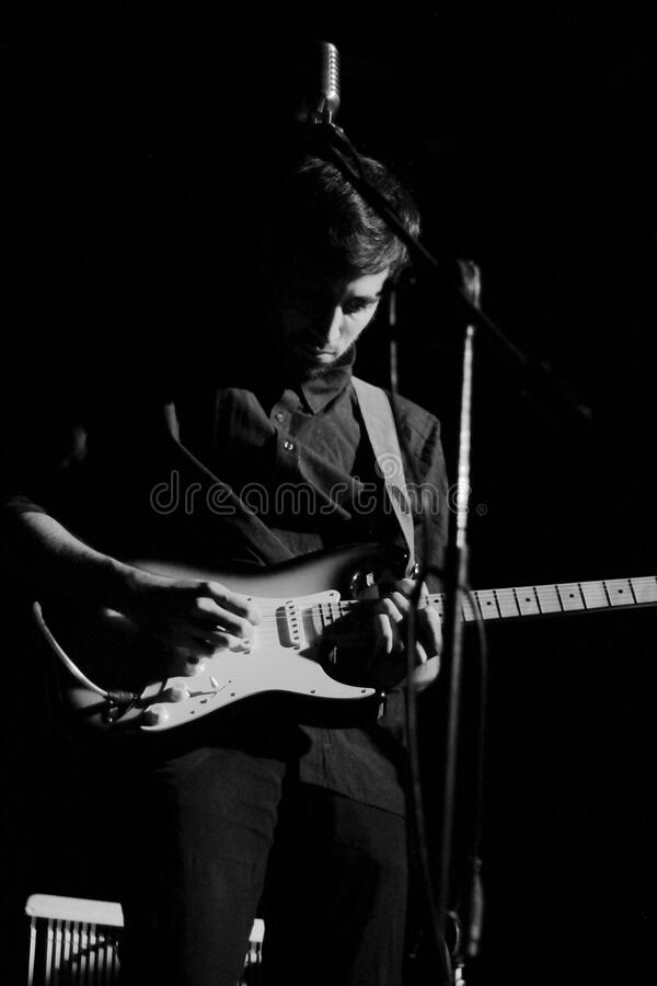 Musician onstage with guitar stock photos