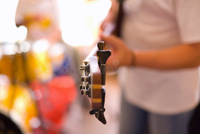 Musician play on bass guitar