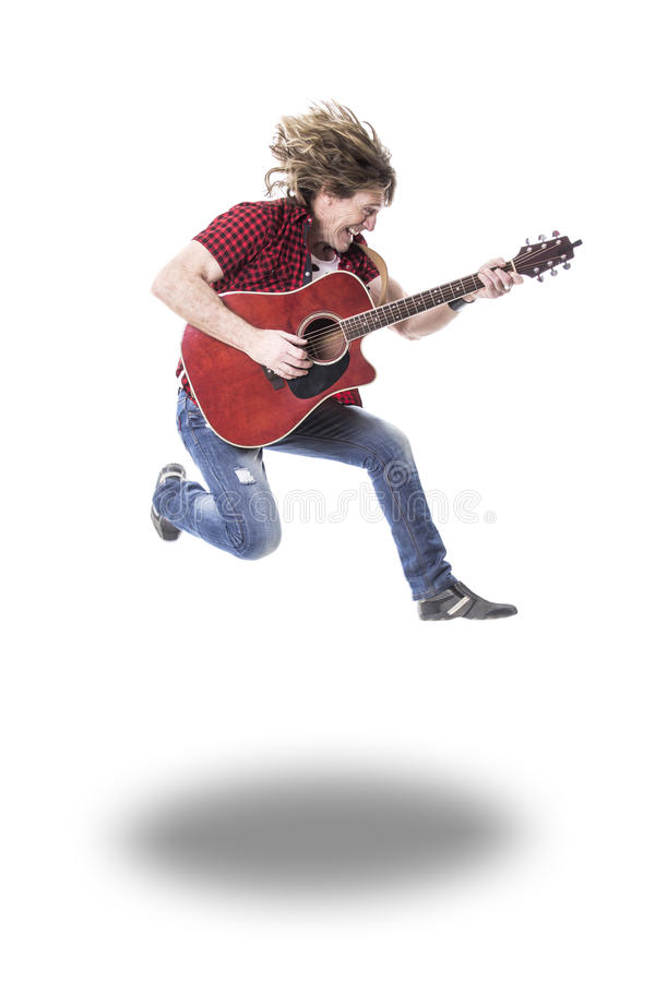 Musician play guitar on studio. A nice musician play guitar on studio royalty free stock photography