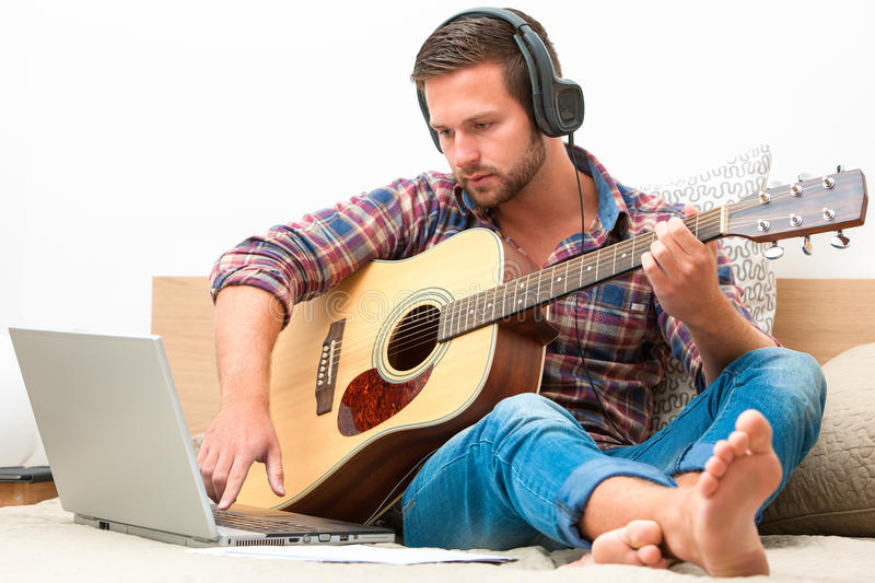 Musician playing acoustic guitar royalty free stock photo