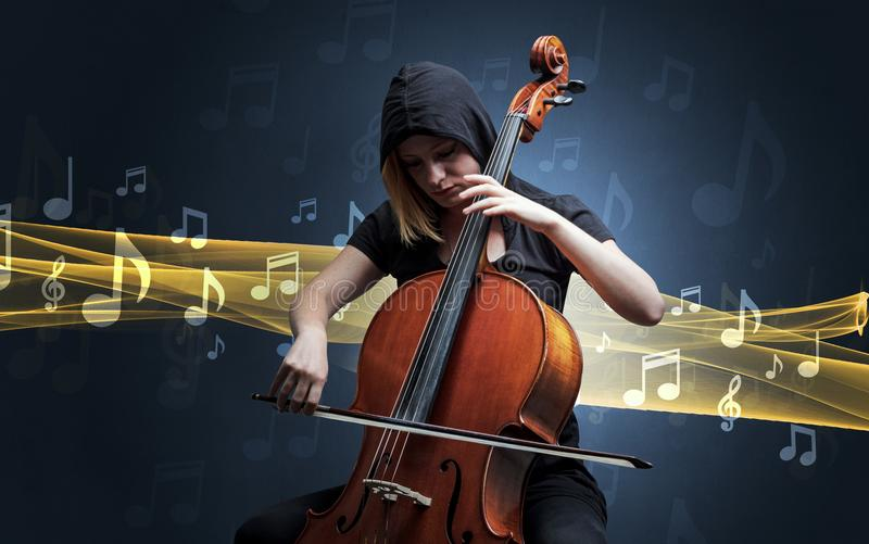 Musician playing on cello with notes around. Young male musician playing on his cello with musical notes around royalty free stock photo
