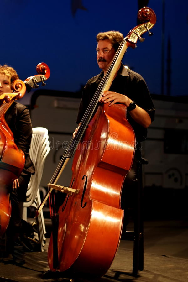 Musician playing contrabass stock photo