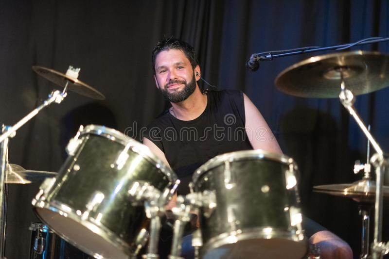 Musician Playing Drums And Cymbals At Concert. Musician Playing Drums And Cymbals At Concert stock photography