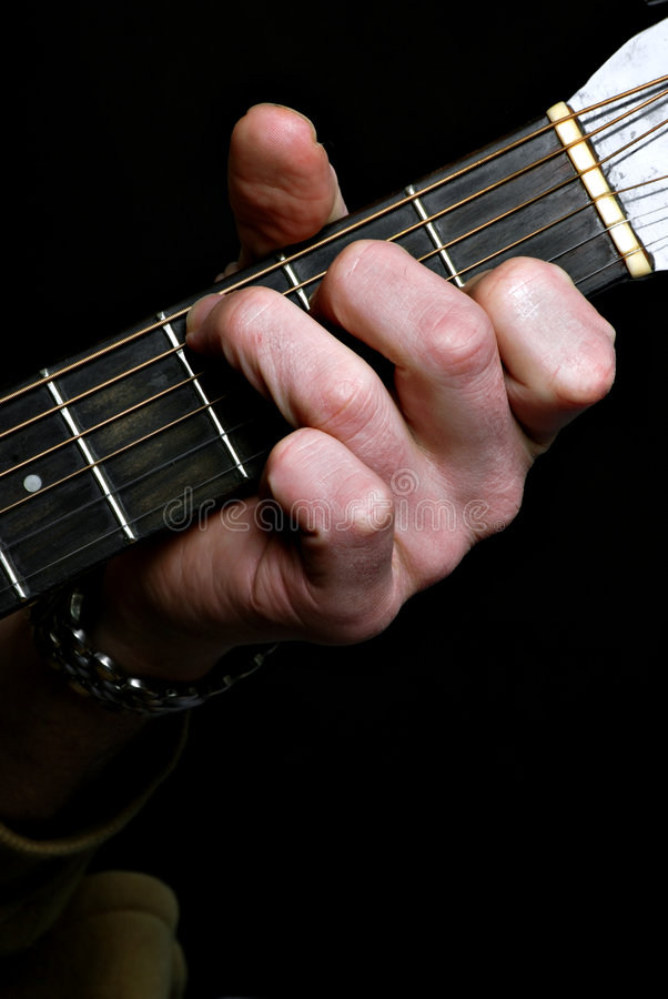 Musician playing guitar royalty free stock photos