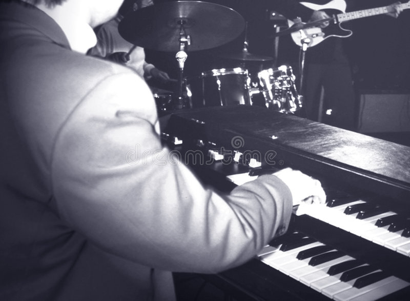 Musician playing hammond organ stock image