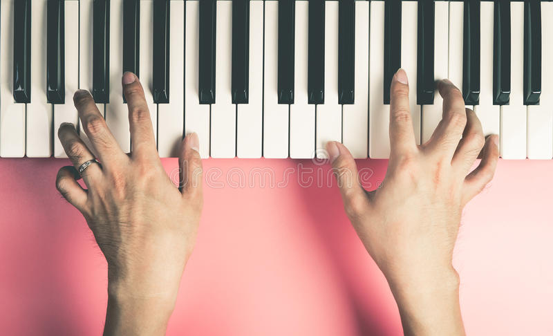 Musician is playing on keyboard royalty free stock photos