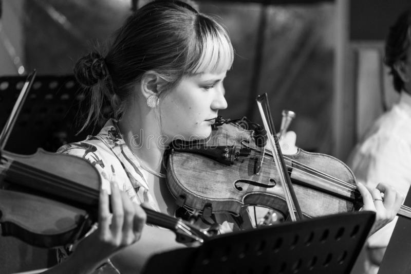 Violinist playing Klezmer at a concert at the Jewish Culture Festival, hosted annually in Kazimierz, Krakow, Poland. Musician playing at a Klezmer concert at the royalty free stock photo