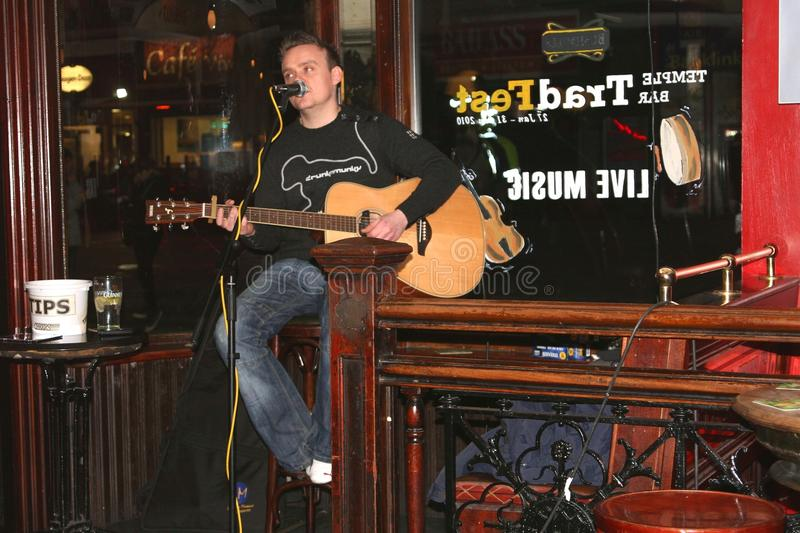 Live music concert of a musician in pub in Dublin, Ireland royalty free stock photo