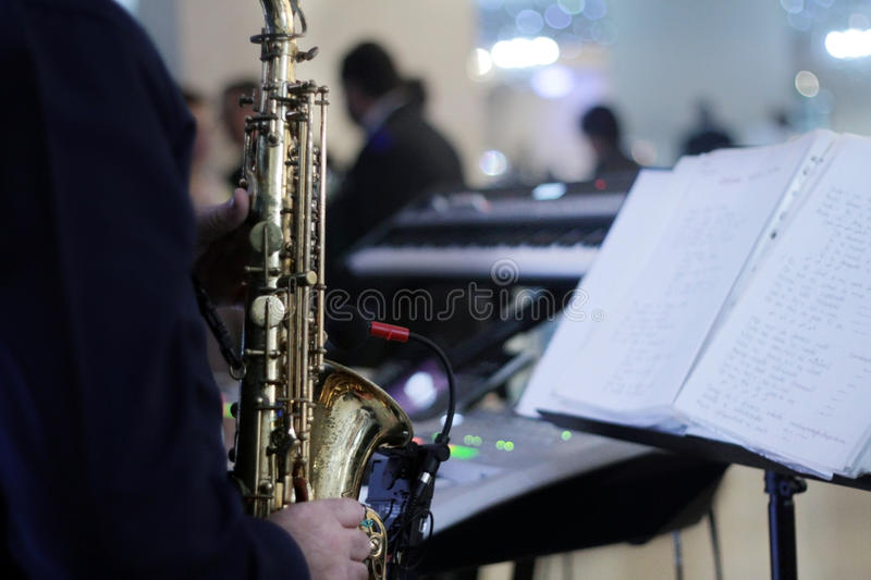 Musician playing at party stock images