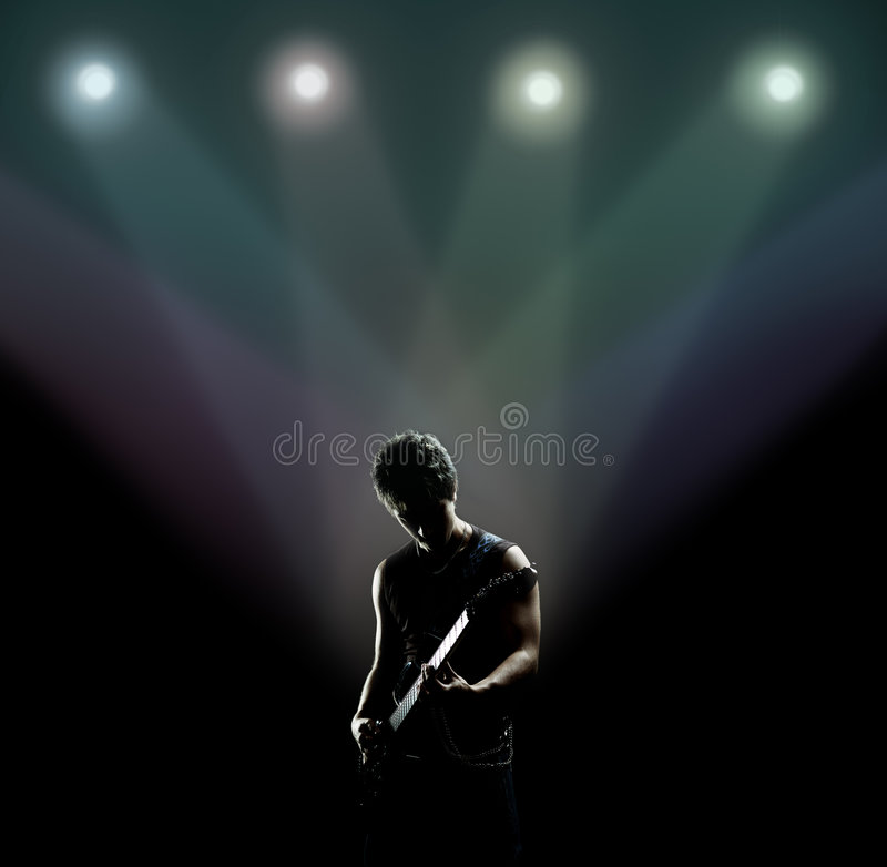 Free Musician Playing The Guitar On The Stage Royalty Free Stock Photos - 8116118